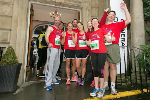 a group of fundraisers in red shirts