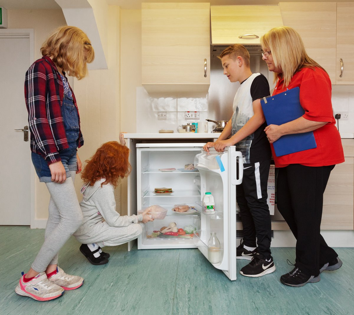 Children looking at the contents of a fridge